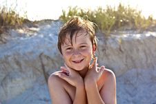 Young Happy Smiling Boy At The Beach Stock Photos