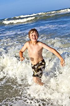 Free Young Boy Enjoys The Waves Of The Blue Sea Royalty Free Stock Photography - 15811627