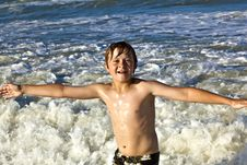 Free Young Boy Enjoys The Waves Of The Blue Sea Stock Images - 15811674