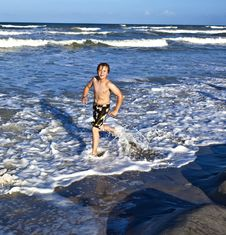Free Young Boy Enjoys The Waves Of The Blue Sea Stock Images - 15811744