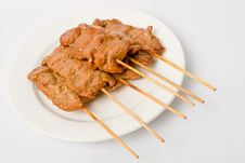 Barbecued Meats On White Dish Stock Image