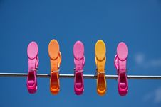 Pink And Orange Clothespins Stock Photo