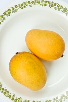 Free Ripe Golden Mangoes On White Dish Stock Photo - 15815400