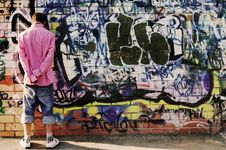 Free Teenager Against Graffiti Wall. Stock Images - 15816484