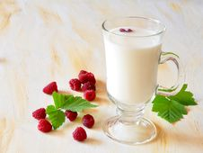Glass Of Milk And Raspberry Royalty Free Stock Photography
