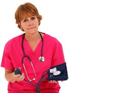 Free Nurse Holding Blood Pressure Monitor Stock Photos - 15821023