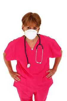 Free Nurse With Mask Looking Up Royalty Free Stock Images - 15821079