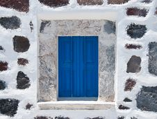Stone Wall With Blue Window Stock Photography