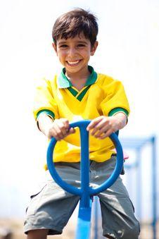 Free Young Kid Enjoying Swing Ride Royalty Free Stock Photos - 15822658