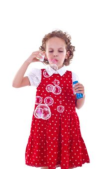 Free Little Girl Blowing Soap Bubbles Royalty Free Stock Photography - 15824597