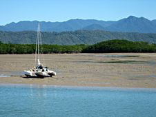 Catamaran On Tidal Mud Flats Royalty Free Stock Photography