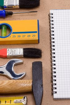 Pad And Set Of Tools Royalty Free Stock Photo