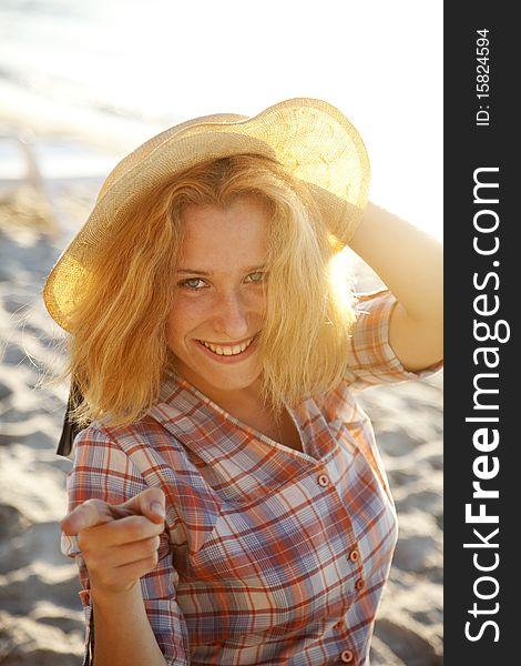 Portrait of beautiful blonde girl in cap