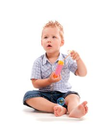 Baby Playing With Soap Bubbles Royalty Free Stock Image