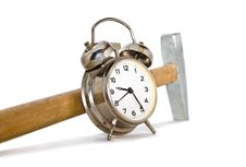 Alarm Clock And Hammer Royalty Free Stock Photos