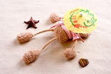 Free Plush Toy Under The Beach Umbrella Royalty Free Stock Image - 15838766