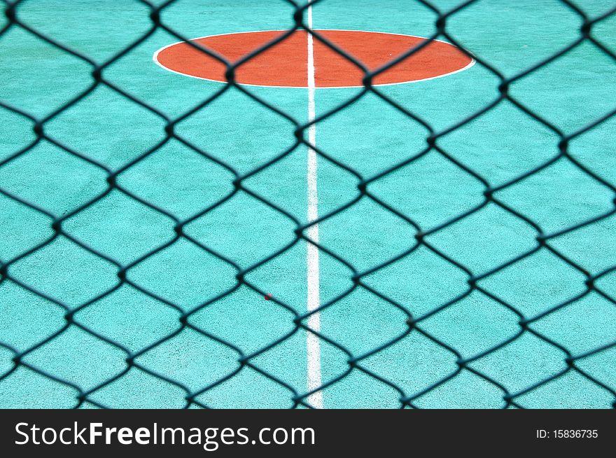 Tennis court behind surround net
