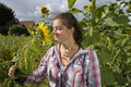 Free Girl Smelling On A Sunflower Stock Image - 15840631