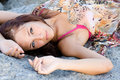 Free Portrait Of A Young  Woman Lying On A Rock Royalty Free Stock Photo - 15840885