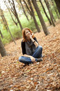 Free Beautiful Red-haired Girl In Autumn Park Stock Photo - 15849880