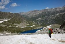 Free Backpacker Walking Down On A Snow Royalty Free Stock Photos - 15840748