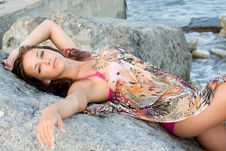 Free Portrait Of A Young Woman Lying On A Rock Royalty Free Stock Image - 15840906