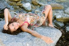 Free Portrait Of A Young Woman Lying On A Rock Royalty Free Stock Photos - 15840928