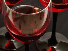 Free Two Glasses Of Red Wine Close-up Over Red Backgrou Stock Images - 15841644