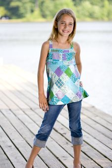 Free Young Pretty Girl Standing On A Dock. Stock Photography - 15842652