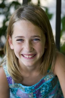 Free Young Tween Girl Laughing At Camera Royalty Free Stock Image - 15842666