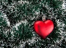 Free Toy In The Shape Of The Heart And Tinsel. Stock Photography - 15844572