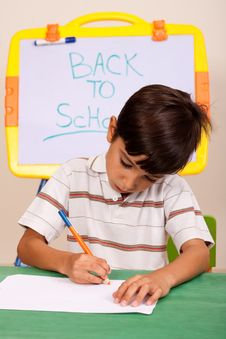 Portrait Of A Young Boy Writing Notes Royalty Free Stock Photography