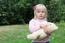 Baby Girl Holding Her Toy Bear