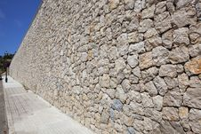 Street Along The Cobblestone Wall Royalty Free Stock Photo