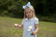 Free Little Girl Holding A Flower Royalty Free Stock Photography - 15849107