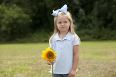 Free Little Girl Holding A Flower Royalty Free Stock Images - 15849119