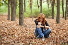 Free Beautiful Red-haired Girl In Autumn Park Royalty Free Stock Images - 15849819
