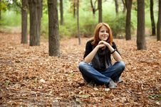 Free Beautiful Red-haired Girl In Autumn Park Stock Photo - 15849860