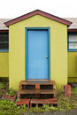 Free Green Building With A Blue Door Stock Photos - 15852983