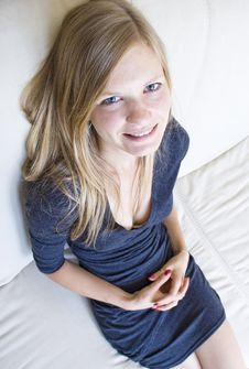 Young Girl Sitting On The Couch