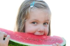 Free Girl Eating Watermelon Royalty Free Stock Photos - 15851448