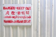 Danger Signboard On White Fence