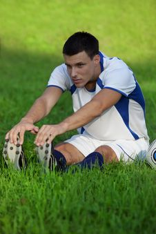 Free Young Soccer Player On Green Grass Royalty Free Stock Photography - 15854827