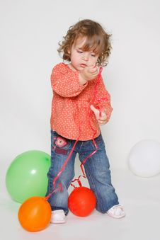 Free Little Girl Playing With Colorful Balloons Stock Images - 15857944