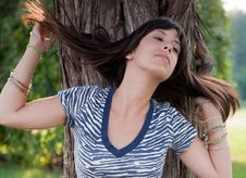 Sexy Young Woman Flipping Hair In Front Of Tree Royalty Free Stock Image