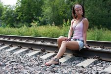 Free Slim Lady Is Sitting On A Railroad Stock Photo - 15863250