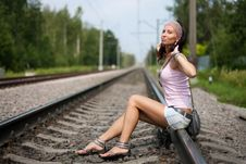 Free Slim Lady Is Sitting On A Railroad Stock Images - 15863294