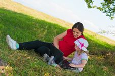 Mother And Little Girl Outdoor With Laptop Royalty Free Stock Photo