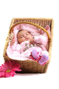 Free Newborn Baby Girl In A Basket, White Beads Royalty Free Stock Image - 15869036