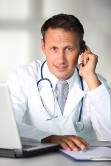 Free Doctor Talking On The Phone Stock Image - 15869241
